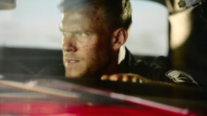 "BLOOD DRIVE -- ""The Fucking Cop"" Episode 101 -- Pictured: Alan Ritchson as Arthur -- (Photo by: Syfy)"
