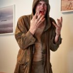 The Homeless Guy (Bill Moseley) is horrified to find his cup full of blood instead of coffee.  Photo by Geoff George for Shaftesbury   Copyright: Shaftesbury