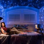 Kat (played by Laura Marano) sits under the stars with her dog Bruno (played by Capone).